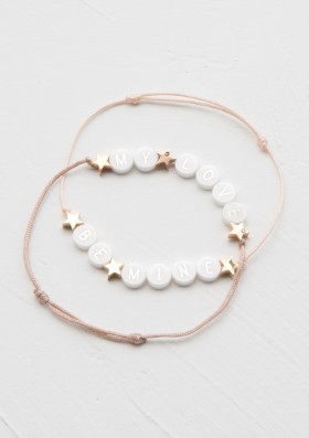 ceramic bracelet with 3 gold stars