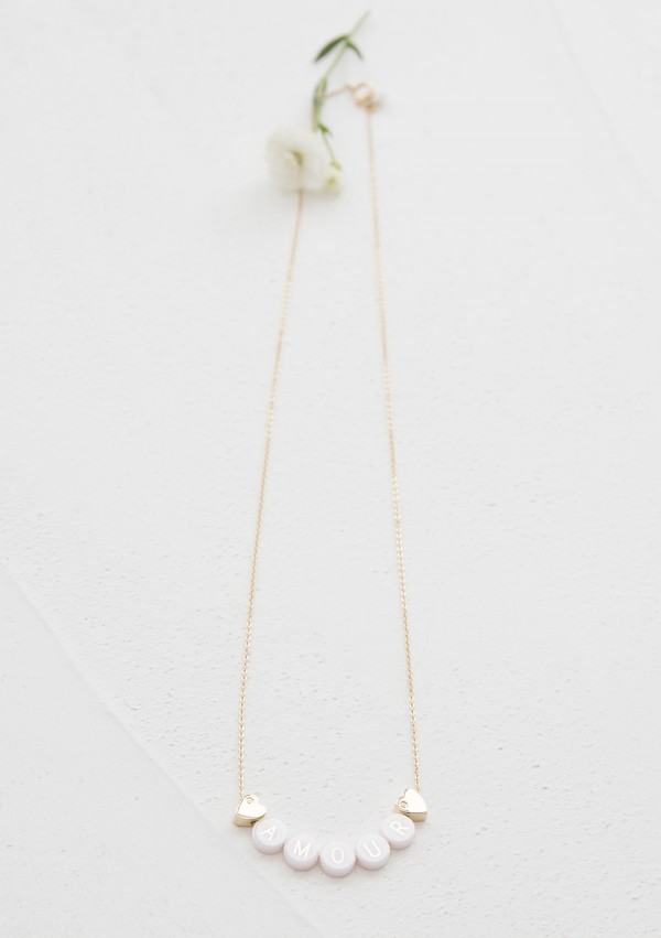 ceramic long necklace + 2 plated gold hearts