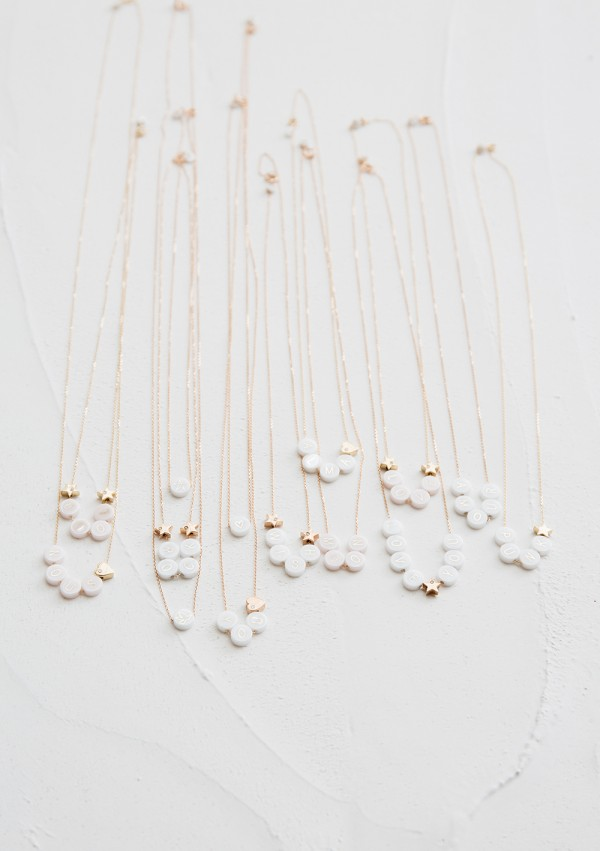 ceramic long necklace + 2 gold and diamond hearts