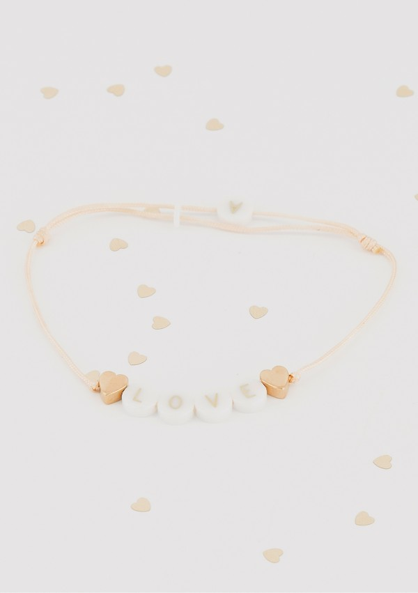 ceramic bracelet with 2 gold hearts