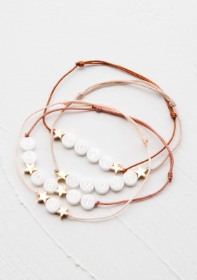 ceramic bracelet with 2 gold stars